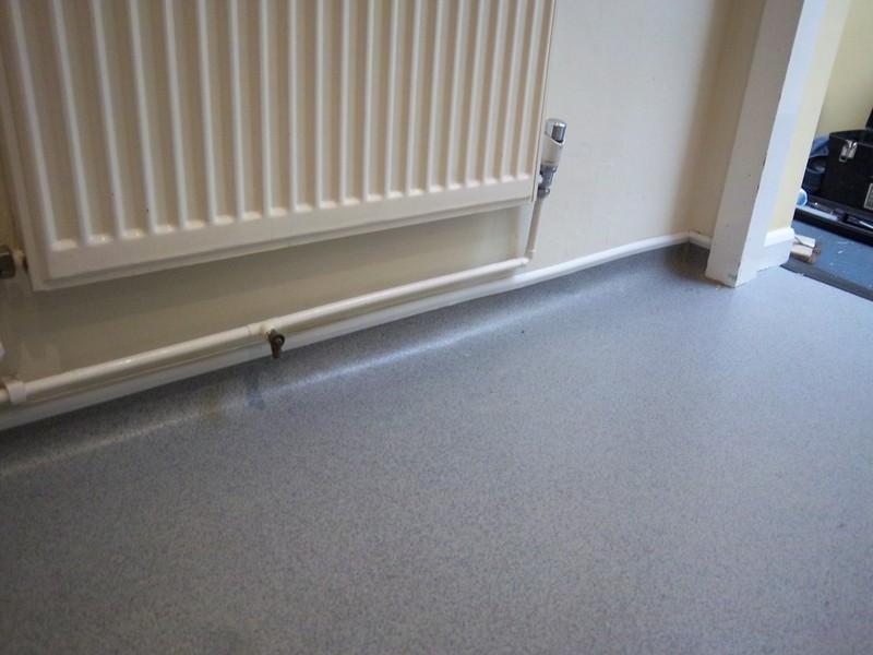 Can i install tile over linoleum floor