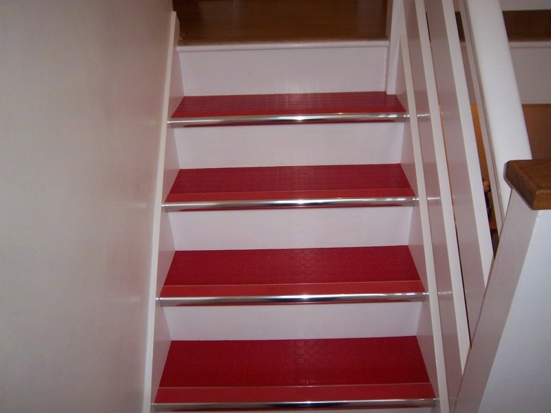 Red rubber and chrome stair nosings on stairs